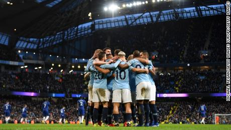 Manchester City players celebrate as they go five goals up against Chelsea.