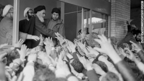 Ayatollah Rouhollah Khomeini greets the crowd at Tehran University after his return to Iran during the Iranian Revolution.