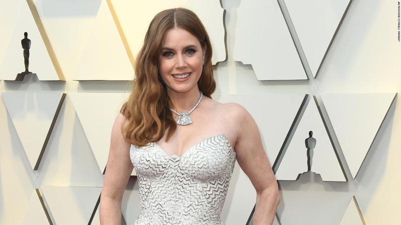 Best supporting actress nominee Amy Adams wore a figure-hugging white gown with silvery zigzag accents. Adams paired the Versace gown with diamond accessories.