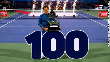 Federer claims 100th title with revenge victory