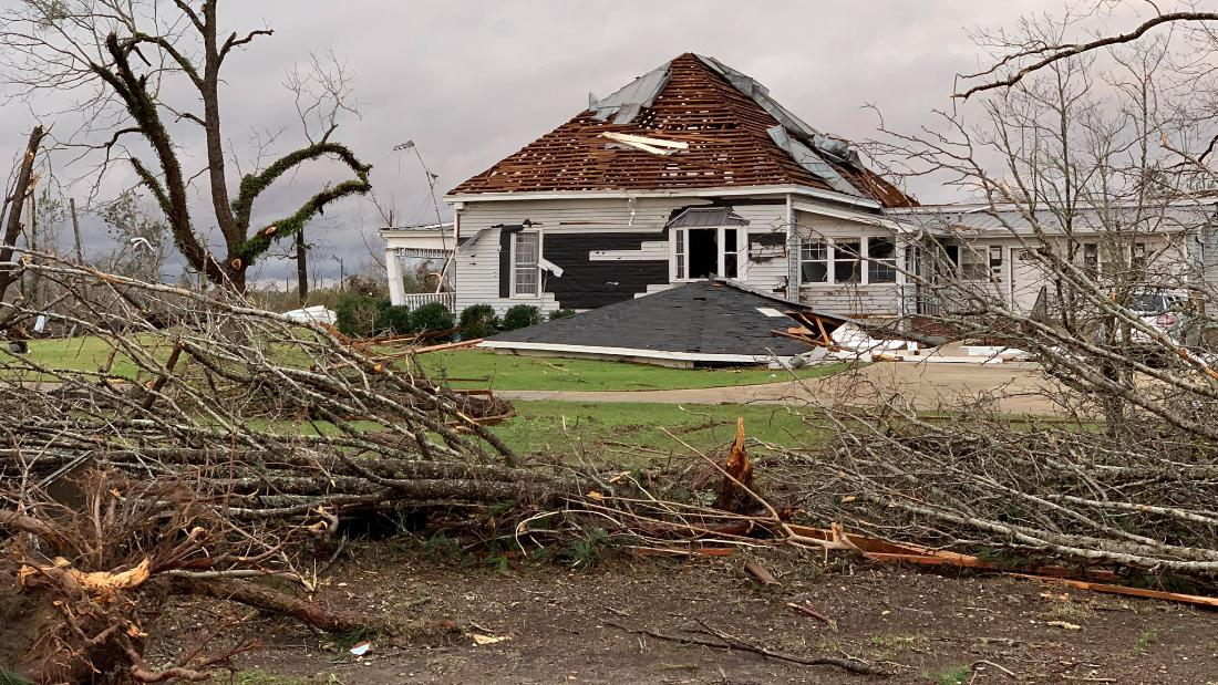 A home's roof is damaged after a tornado hit Beauregard on Sunday, March 3.