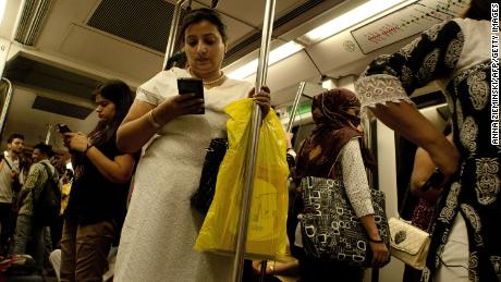 On 3 July 2015 Indian women use their smartphones as they travel in the carriage reserved for women on the New Delhi subway.