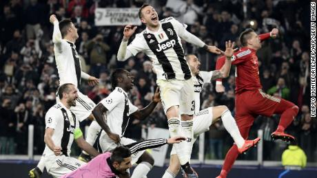 Juventus players celebrate after defeating Atletico Madrid in Turin.