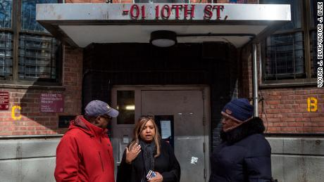 Patton leads a walking tour of Queensbridge Houses in New York.