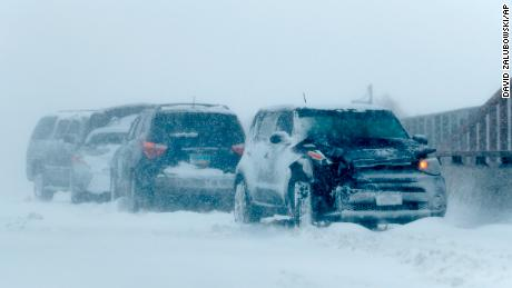 A row of destroyed vehicles sit on a flyover over Interstate 70 when a storm with storm wind blows over the Intermountain West Wednesday, March 13, 2019, in Aurora, Colo.