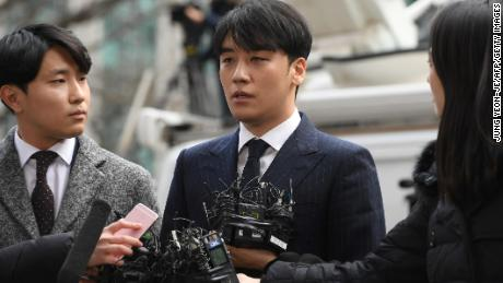 Seungri speaks to the media as he arrives for questioning over criminal allegations at the Seoul Metropolitan Police Agency in Seoul on March 14, 2019.