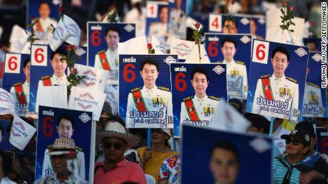 Supporters of the Phalang Pracharat party hold placards in support of their candidates during a campaign rally in Chonburi province on March 21, 2019.
