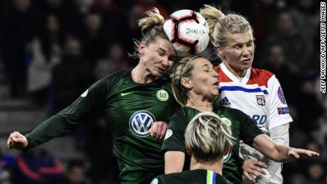 Hegerberg (R) heads the ball in a Champions League quarterfinal match against Wolfsberg.