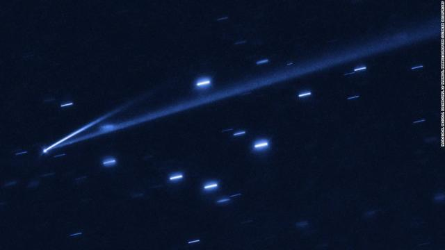 The asteroid 6478 Gault is seen with the NASA/ESA Hubble Space Telescope, showing two narrow, comet-like tails of debris that tell us that the asteroid is slowly undergoing self-destruction. The bright streaks surrounding the asteroid are background stars. The Gault asteroid is located 214 million miles from the Sun, between the orbits of Mars and Jupiter.