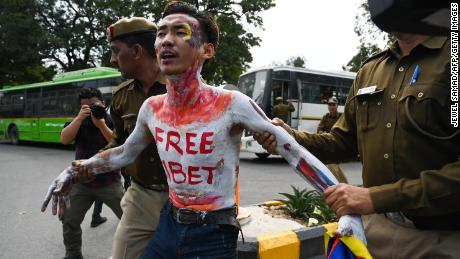 A Tibetan exile activist is detained by Indian police during a protest to commemorate the anniversary of the 1959 Tibetan uprising against Chinese rule, near the Chinese embassy in New Delhi on March 12, 2019.