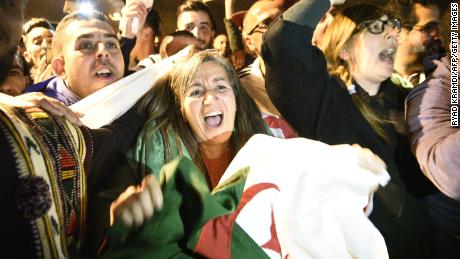 Algerians celebrate after the country's veteran President Abdelaziz Bouteflika informed the Constitutional Council that he was resigning on Tuesday.
