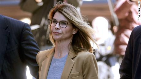 Lori Loughlin and her husband are accused of paying $500,000 to get their daughters into USC.