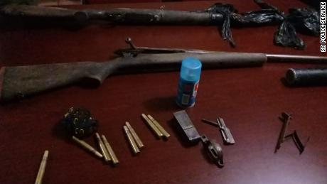 Police say they arrested three men and seized guns following the alleged poacher's death.