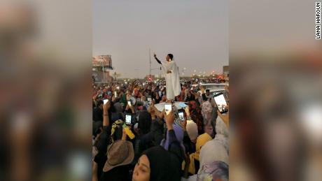 The 22-year-old activist in that iconic photo says she chanted from atop a car to declare, 'Sudan is for all'