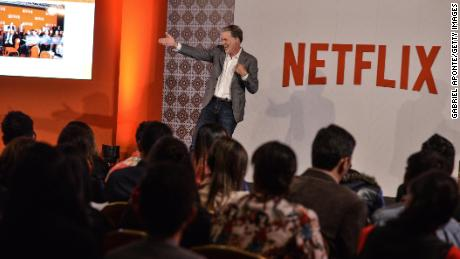 Netflix added record number of subscribers, but warns of tougher times ahead