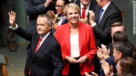 Opposition leader Bill Shorten and Deputy Opposition Leader Tanya Plibersek wave after delivering their budget reply on April 4 in Canberra.