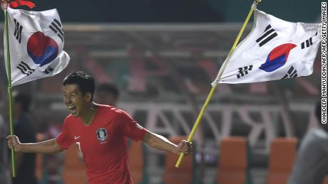 South Korea's forward Heung Min Son celebrates after winning gold at the 2018 Asian Games.