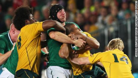 Stephen Ferris tackles Australia's Will Genia at the 2011 World Cup