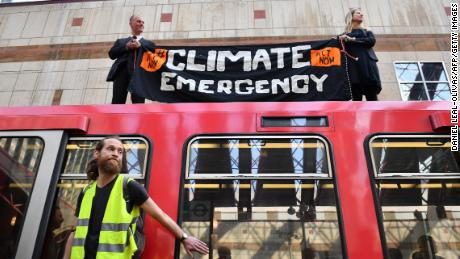 Activists glue themselves to London train on third day of climate protests