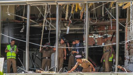A Sri Lankan officer inspects a blast site at the Shangri-La hotel in Colombo.