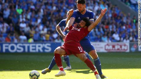 Mohamed Salah is hauled to the ground by Sean Morrison for a Liverpool penalty.
