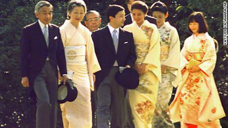 Emperor Akihito and Empress Michiko, left, lead their two sons, accompanied by their spouses, and a daughter during the annual autumn imperial garden party at Akasaka Palace in Tokyo in 1997.