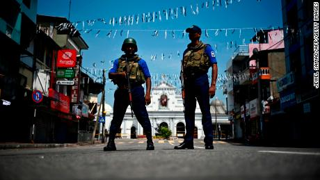 Security personnel stand guard near St. Anthony's Shrine, one of the Easter Sunday bombing sites.