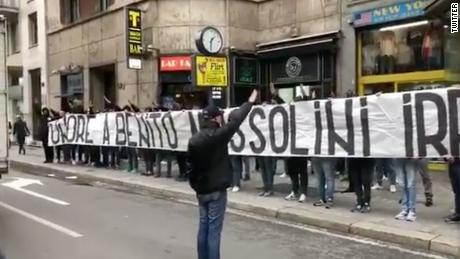 """Lazio fans hold a banner that reads """"Honor to Benito Mussolini"""" in Milan."""