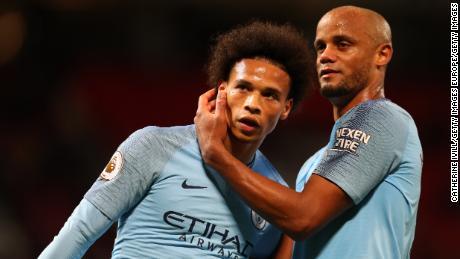 Leroy Sane (L) celebrates with teammate Manchester City Vincent Kompany.