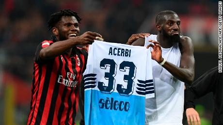 Franck Kessie (L) and Tiemoue Bakayoko hold the jersey of Lazio's Italian defender Francesco Acerbi after a Serie A league match.