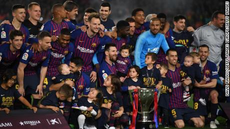 Barcelona celebrate winning the La Liga title with three games to spare.