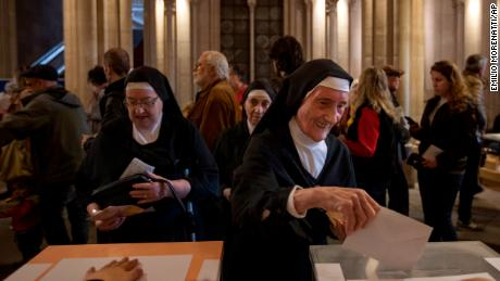 A nun votes in Barcelona on Sunday during the third Spanish general election in four years.