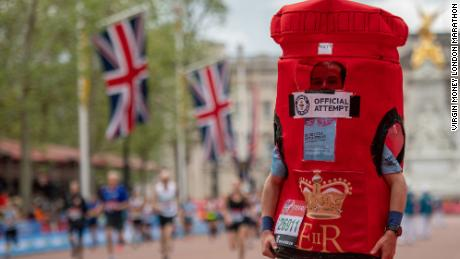 Matthew Collins -- the fastest man to run the marathon ... dressed as a post box
