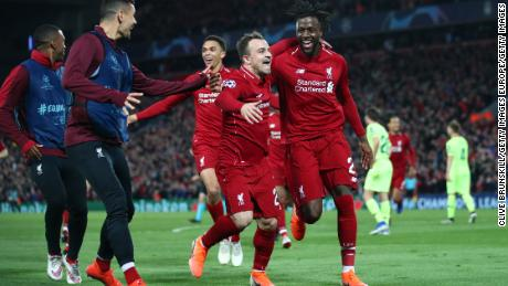 Divock Origi of Liverpool (27) celebrates as he scores his team's fourth goal against Barcelona with Xherdan Shaqiri.