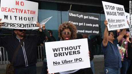 Rideshare drivers for Uber and Lyft stage a strike and protest at the LAX International Airport, over what they say are unfair wages in Los Angeles, California on May 8, 2019.
