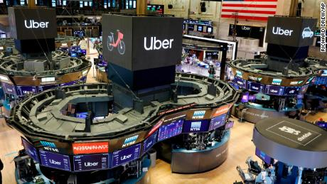 Uber logos top trading posts on the floor of the New York Stock Exchange on Friday.