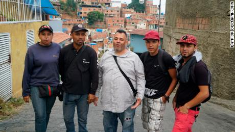 Colectivo leader Naudy Mendez stands at the center with four of his lieutenants in the Antímano neighborhood of Caracas.