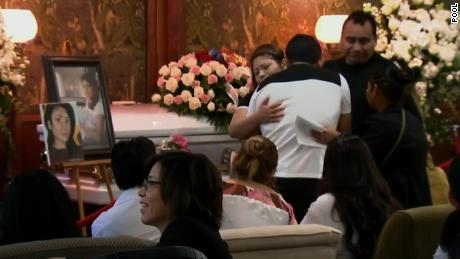 Mourners embrace on Saturday at Ochoa-Lopez's funeral in Chicago.