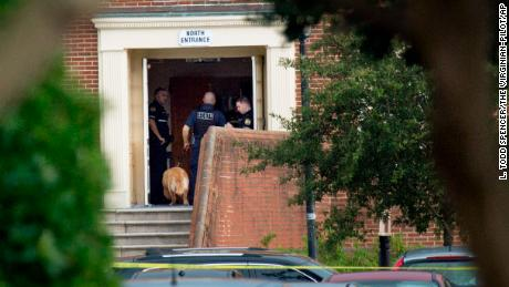 Police work the scene where 12 people were killed during a mass shooting at the Virginia Beach city public works building.