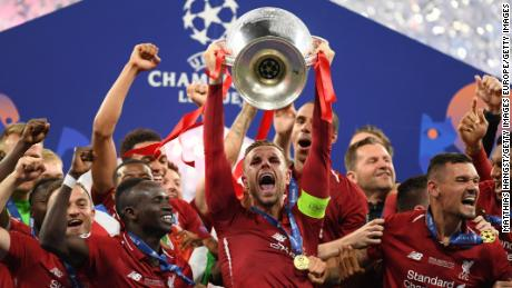 Liverpool's Jordan Henderson lifts the Champions League trophy after winning the UEFA Champions League final between Tottenham Hotspur and Liverpool at the Estadio Wanda Metropolitano on June 01, 2019 in Madrid.