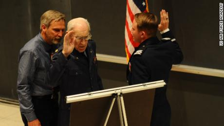 The elder Kloc, 101, received a standing ovation from the crowd, the Air Force Academy said.