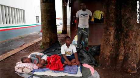 A family of Haitian migrants waits at an immigration center in Tapachula, Mexico, on May 29, 2019.