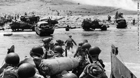 US assault troops and equipment landing on Omaha beach the day following D-Day