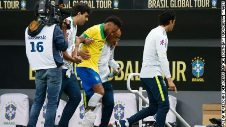 Neymar limped off during Brazil's 2-0 win over Qatar in Brasilia.