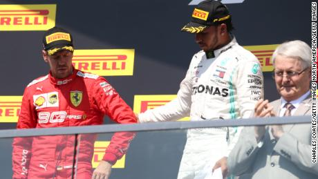 Sebastian Vettel reluctantly made his way to the podium after the stewards' decision at the Canadian GP.