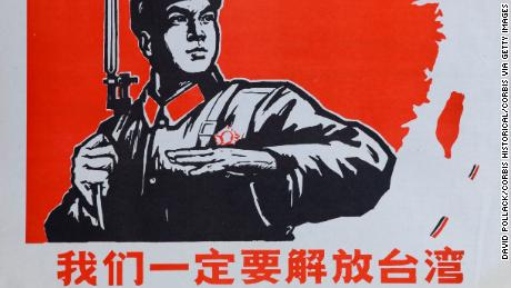 "An historic Chinese Cultural Revolution poster, showing a Chinese soldier and the island of Taiwan. ""We must liberate Taiwan,"" the caption says."