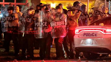 Shelby County sheriff's deputies brace against the crowd as protesters throw rocks Wednesday night.