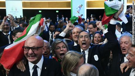 Members of the Milan bid celebrate the IOC's decision.