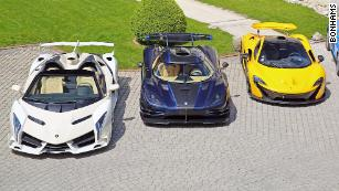 Supercars seized from politician auctioned in Switzerland