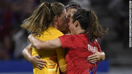 United States goalkeeper Alyssa Naeher is mobbed by teammates after her crucial penalty save.